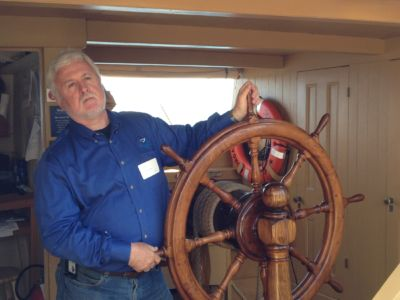 At The Helm Of The Historic American Whaling Ship Charles W. Morgan On Its 38th Voyage, Off Cape Cod, 2014