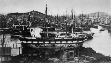 This ca. 300 ton barque is a close match for either Candace or Harvest. It is moored at what today would be near the intersection of Spear and Folsom streets. The barque lies off the Folsom Street alignment; the line of capped pilings visible behind its stern is the property line of the waterlot. They outline the southern boundary of Folsom while the vessel lies across the Spear street alignment, as does the steamboat and the housed-over storeship behind (north) of the vessel. San Francisco Maritime National Historical Park, J. Porter Shaw Library, A11.4528-c.